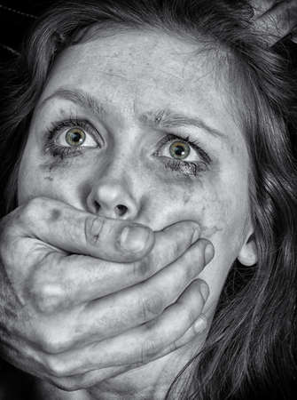 brawl: Portrait of scared woman with tears  Violence concept  Black and white Stock Photo