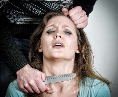 girl with knife: Man holding knife near woman