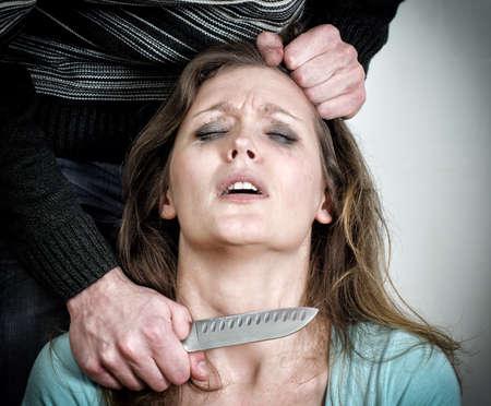 brawl: Man holding knife near woman
