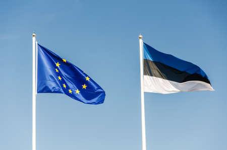 estonian: Two flags: Estonian and Europe Union