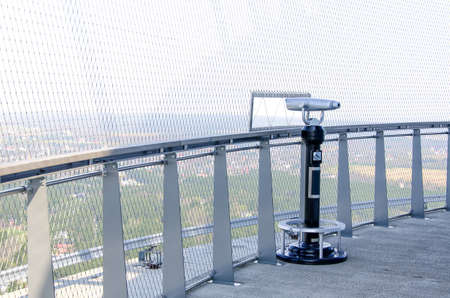 Coin operated panoramic telescope on TV-tower photo