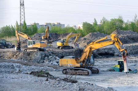 Several excavators on construction site