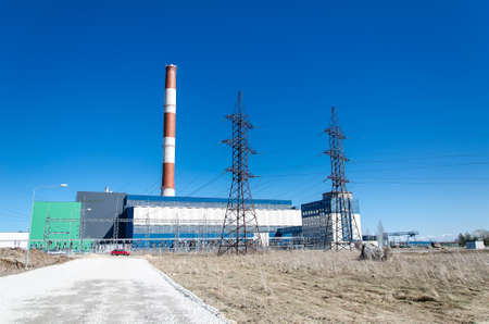 Electric power plant over blue sky. photo