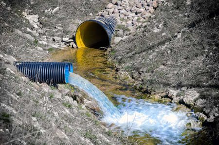 water sanitation: Waste water pipe polluting environment