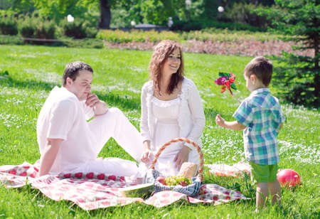 picnic blanket: Happy family have picnic in the park