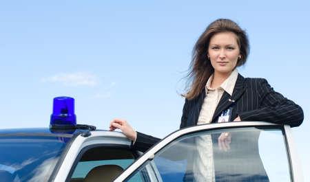 police girl: Young female FBI agent standing near car open door
