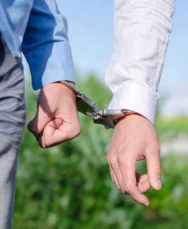 enchain: Two FBI agents conduct arrest of an offender