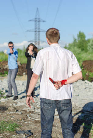 Two FBI agents arresting an offender with knife photo