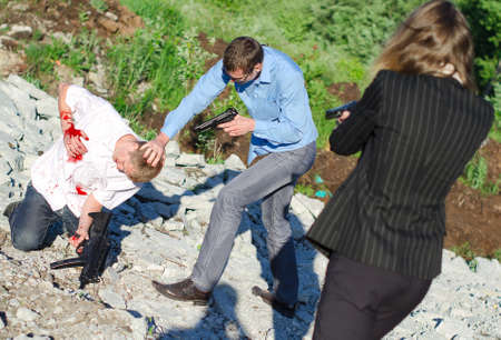 offender: Two FBI agents arresting an offender with knife Stock Photo