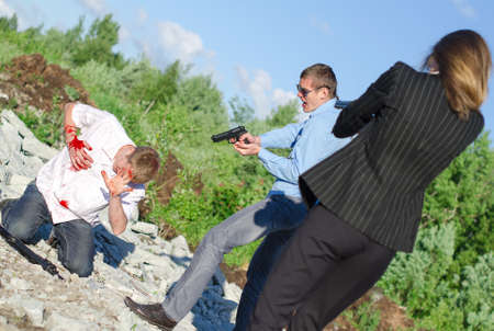 arresting: Two FBI agents arresting an offender with knife Stock Photo