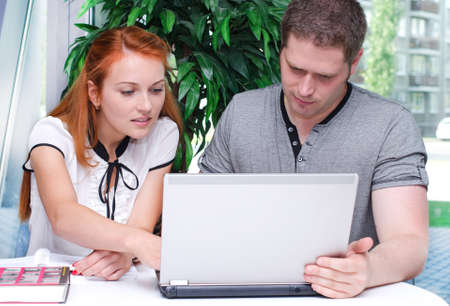 tutorial: Male and female students studying using laptop Stock Photo