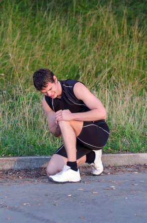Sportsman holding his leg  Sports injury concept Stock Photo - 21894072