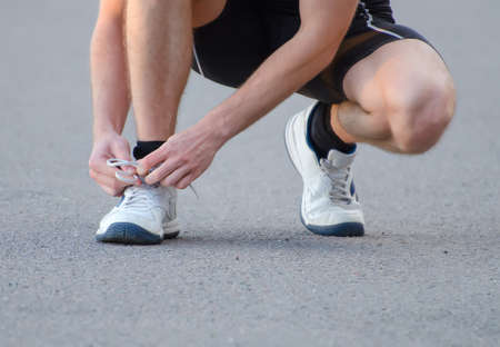 Man tying his sport shoes Stock Photo