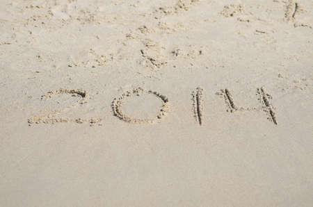 2014 written on sand beach. photo