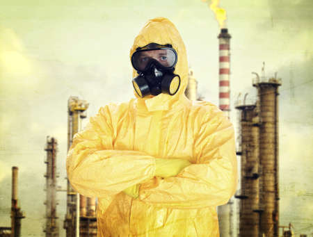 Man in chemical protective suit over factory photo