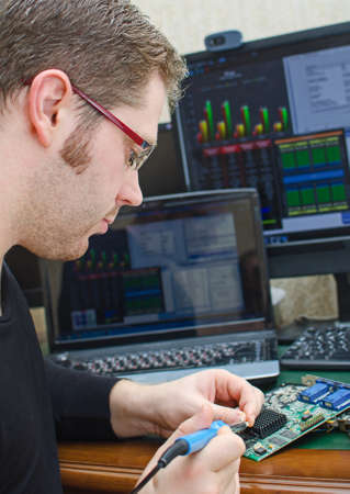 rosin: Worker repairing computer equipment with soldering iron