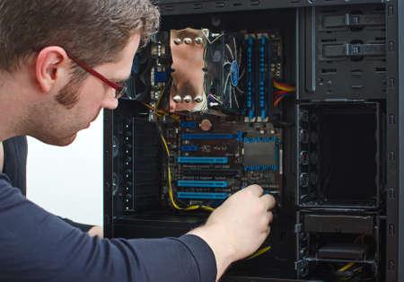 technician: Male technician repairing computer at store