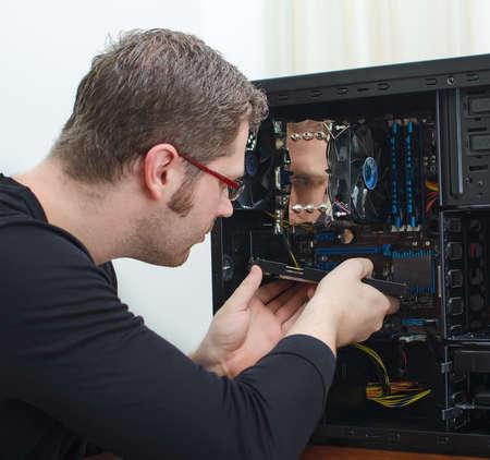 hardware repair: Male technician repairing computer at store