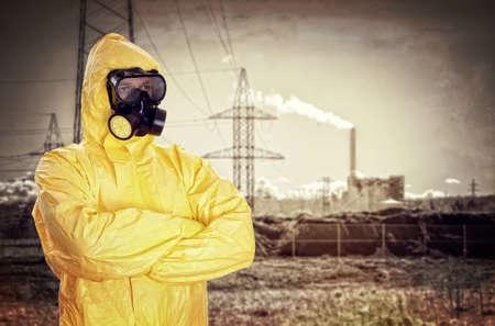 工場に化学防護服の男 写真素材