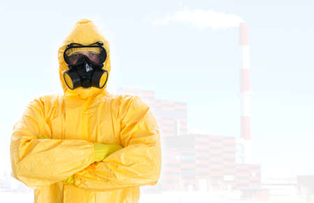 Worker in protective chemical suit  Space for your text  photo