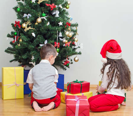 Brother and sister packing christmas gifts photo
