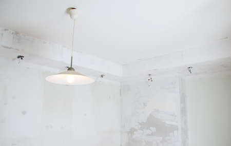 Undone halogen light bulbs on electric wires  photo