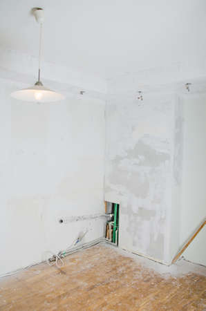 undone: Room renovation  Gypsum plasterboard with undone socket bulbs