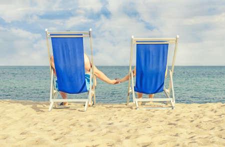 Couple enjoying summer vacation on the beach photo