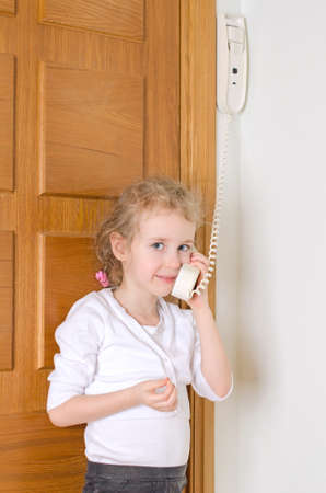 Little girl talking on the intercom at home  photo
