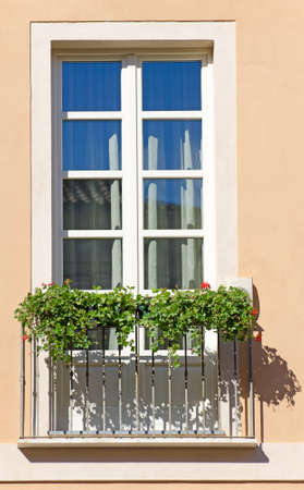 Old italian balcony with flowers  photo