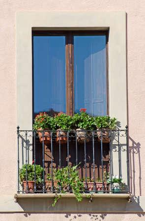 Old italian balcony with flowers  photo