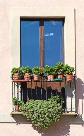 Old italian balcony with flowers  Stock Photo