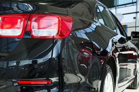 Black new car at dealership salon  Stock Photo