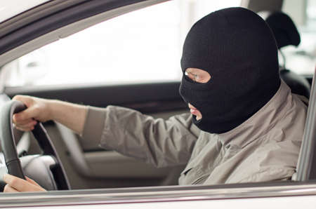 Thief in mask steals expensive new car  photo