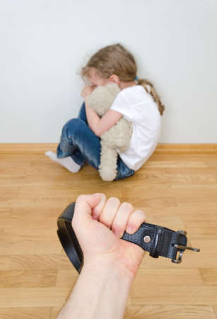 mistreatment: Little girl crying in the corner  Domestic violence concept  Stock Photo