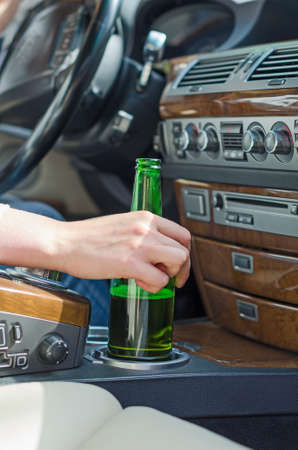 under the influence: Driving Under the Influence  Female hand with bottle of beer