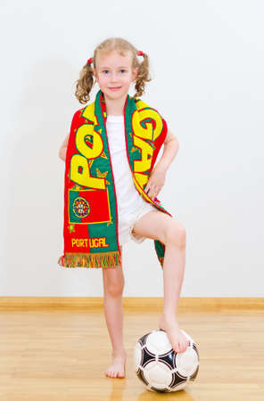 Little girl with ball and Portuguese scarf. photo