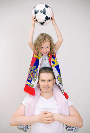 Father and daughter supports their sports team  Stock Photo