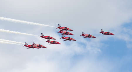 royal air force: TALLINN BAY, ESTONIA - 23 JUNE, Red Arrows Royal Air Force Aerobatic Display above Tallinn Bay at 23 06 2014