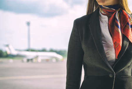 Stewardess on the airfield  Place for your text