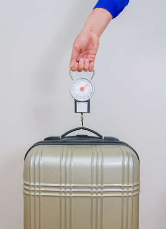 steelyard: Hand luggage measurement using steelyard balance  Stock Photo