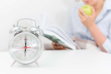 Schedule of the day  Woman resting at home, reading a book Stock Photo - 30419232