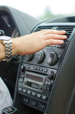 cold air: Man using automobile air conditioning system