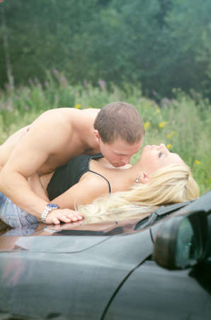 nude outdoors: Sensual couple making love on the car Stock Photo