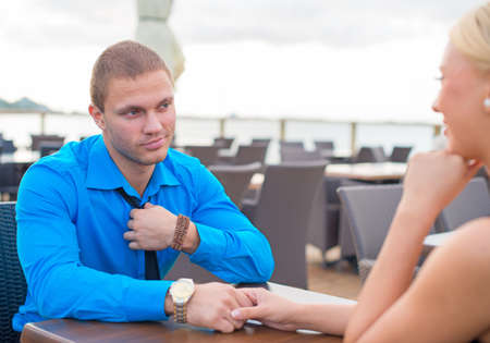 faithlessness: Man making proposal to woman in outdoor cafe