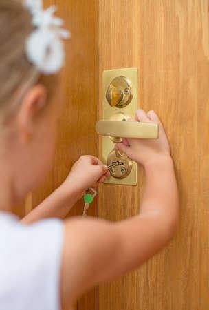 Little girl opening door to someone  photo