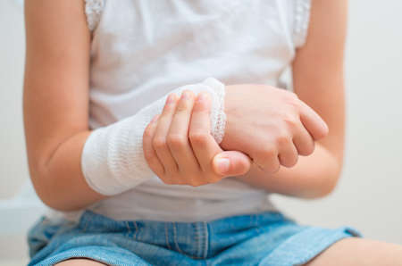 Child arm with gauze bandage on it  photo