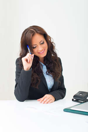 Attractive business woman working with documents in office. photo