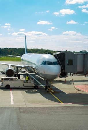 fuselage: Passenger plane maintenance in airport before flight.