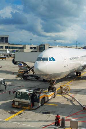 Passenger plane maintenance in airport before flight.